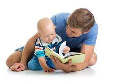 Kid boy and his father read a book Stock Photography