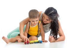 Kid boy and his mom play with toy Royalty Free Stock Image