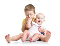 Kid boy and his sister baby girl isolated on white Royalty Free Stock Image