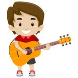 Kid Boy Holding and Playing a Guitar Stock Photo