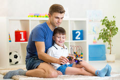 Kid boy holding a radio remote control for Royalty Free Stock Photography