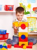 Kid boy in kindergarten. Stock Photos