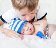 Kid boy looking at sleeping newborn brother Royalty Free Stock Photography