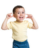 Kid boy making funny faces. Isolated Stock Image