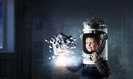 Innovative impressive technologies. Kid boy and media cube figure as symbol for technologies. 3d rendering Royalty Free Stock Photo