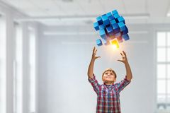 Innovative impressive technologies. Kid boy and media cube figure as symbol for technologies. 3d rendering Stock Photo