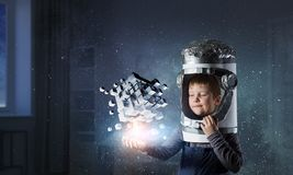 Innovative impressive technologies. Kid boy and media cube figure as symbol for technologies. 3d rendering Stock Photos