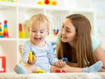 Kid boy and mom playing with construction toys. Kid boy playing with construction toys indoor Royalty Free Stock Photos