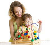 Kid boy and mother play with educational toy Royalty Free Stock Image