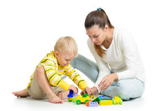 Kid boy and mother play togethe Stock Image