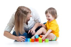 Kid boy and mother play together with construction Stock Images