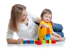 Kid boy and mother play together with construction Stock Photography