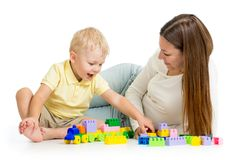 Kid boy and mother play together with construction Royalty Free Stock Photo