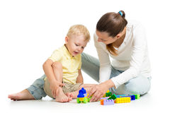 Kid boy and mother play together Stock Photo