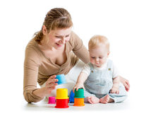 Kid boy and mother play together with cup toys Royalty Free Stock Images