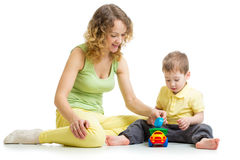 Kid boy and mother play together with toy Royalty Free Stock Images