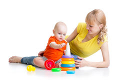 Kid boy and mother play together with toy Stock Photography