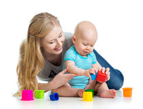 Kid boy and mother play together with toys Royalty Free Stock Images