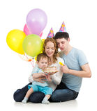 Kid boy with parents looking at festive cake Royalty Free Stock Photos