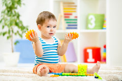 Kid boy playing with block toys at home Stock Image