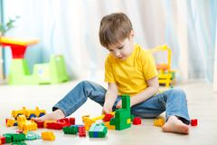 Kid boy playing with block toys at home. Kid playing with block toys at home Stock Image