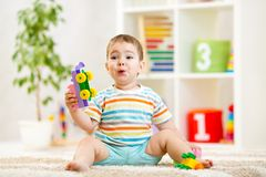 Kid boy playing with block toys indoors Stock Photos