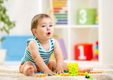 Kid boy playing with block toys indoors Royalty Free Stock Image