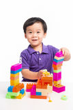 Kid boy playing with blocks from toy constructor.  royalty free stock photo