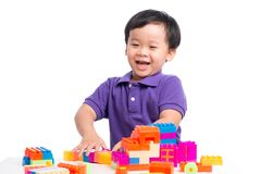 Kid boy playing with blocks from toy constructor isolated.  royalty free stock image