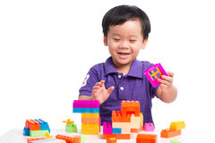 Kid boy playing with blocks from toy constructor isolated.  royalty free stock photography