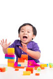 Kid boy playing with blocks from toy constructor isolated.  stock image