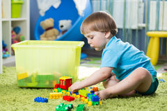 Kid boy playing with construction set Stock Images