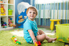 Kid boy playing with construction toys indoor stock photography