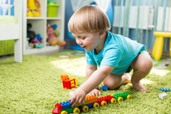 Kid boy playing with construction toys indoor Royalty Free Stock Image