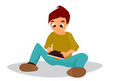 Kid boy playing on a digital tablet Stock Photography