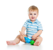 Kid boy playing with musical toys  on white backgroun Royalty Free Stock Photo