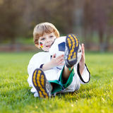 Kid boy playing soccer with football Stock Photography