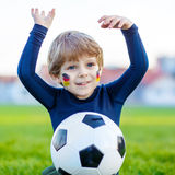 Kid boy playing soccer with football Royalty Free Stock Photo