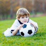 Kid boy playing soccer with football Royalty Free Stock Image