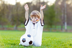 Kid boy playing soccer with football Royalty Free Stock Photography