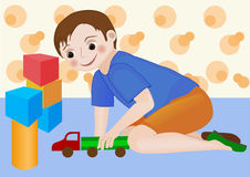 Kid boy playing with toy truck Stock Image