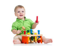 Kid boy playing toy  on white background Royalty Free Stock Photography