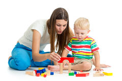 Kid boy playing toys together mother Royalty Free Stock Photos