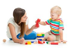 Kid boy playing toys together mother Stock Images
