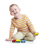 Kid boy playing with train toy. On white background Stock Photos