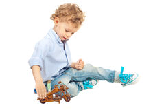 Kid boy playing with wooden bike Stock Image