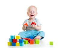 Kid boy playing wooden toys Stock Photography
