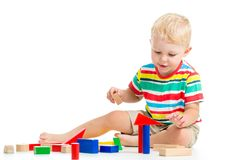 Kid boy playing  wooden toys Stock Photos