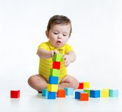 Kid boy playing wooden toys Royalty Free Stock Image