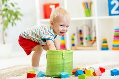 Kid boy playing  wooden toys Royalty Free Stock Photography